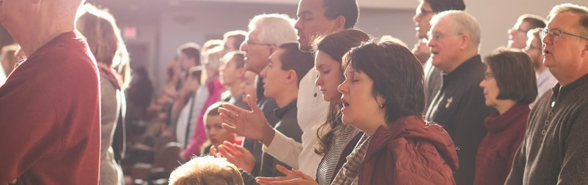 people singing in church